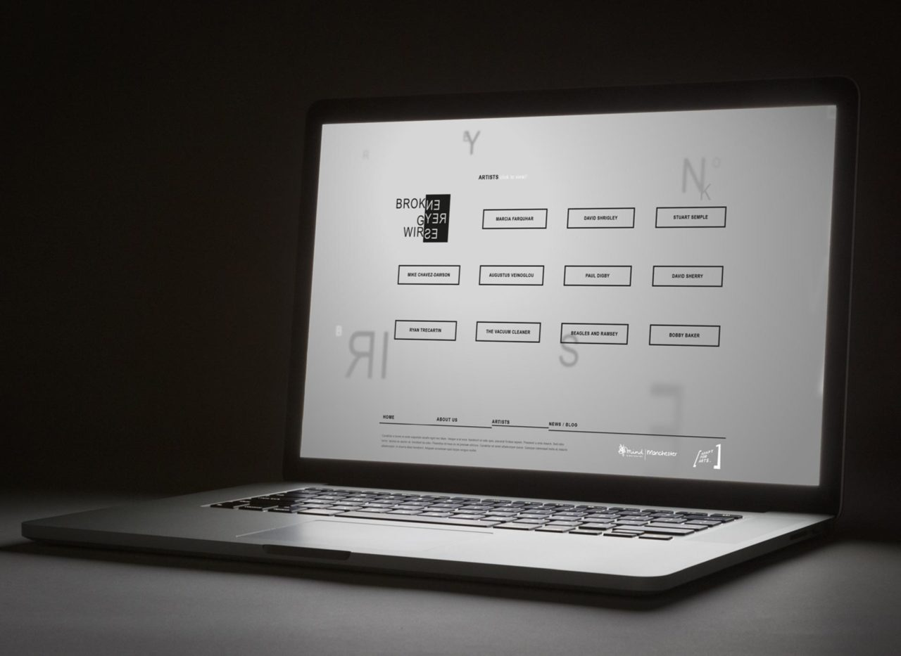 Broken Grey Wires website on a laptop